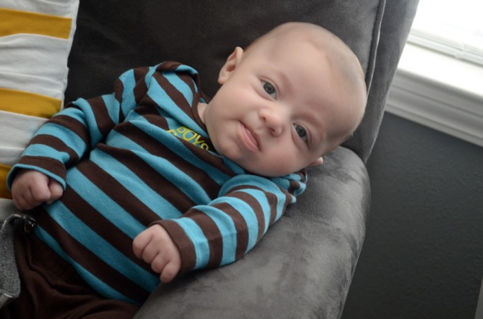 3-month_monkey-stripes_arm-chair-smirk